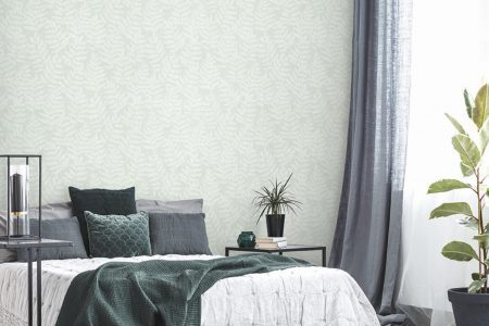 Green blanket on bed in elegant bedroom interior with poster on white wall and plant on the table; Shutterstock ID 1038896041; Purchase Order: -